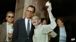 Newlyweds Marilyn Monroe, right, and Arthur Miller are shown after their civil wedding ceremony in White Plains, N.Y., June 29, 1956.