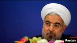 Iran's President Hassan Rouhani arrives to attend a news conference at a hotel after the fourth Conference on Interaction and Confidence Building Measures in Asia (CICA) summit, in Shanghai, May 22, 2014.