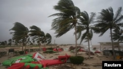 Debris litters a beach after Cyclone Mekunu in Salalah, Oman, May 26, 2018. Cyclone Mekunu blew into the Arabian Peninsula early Saturday, drenching arid Oman and Yemen with rain, downing power lines, officials said.