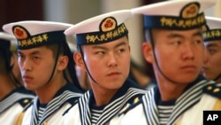 FILE - A military honor guard prepares for U.S. Chief of Naval Operations Admiral Jonathan Greenert's visit with Commander in Chief of the PLA Navy Adm. Wu Shengli at a welcoming ceremony at the PLA Navy headquarters outside Beijing, China, July 15, 2014.