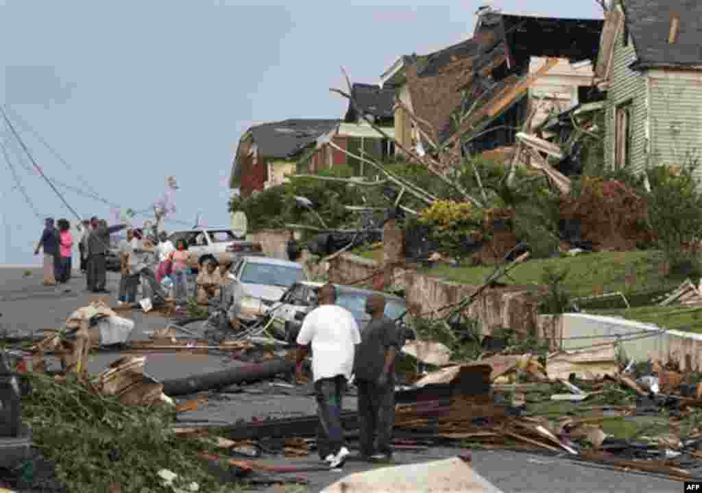 Residents survey the destruction after a tornado hit Pratt City, Ala. just north of downtown Birmingham, Ala., on Wednesday, April 27, 2011. A wave of severe storms laced with tornadoes strafed the South on Wednesday, killing at least 16 people around the