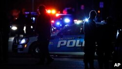 Police search the area where a Wayne State University police officer was shot while on duty near the campus Nov. 22, 2016, in Detroit. Five-year veteran Collin Rose, 29, died Nov. 23, 2016.