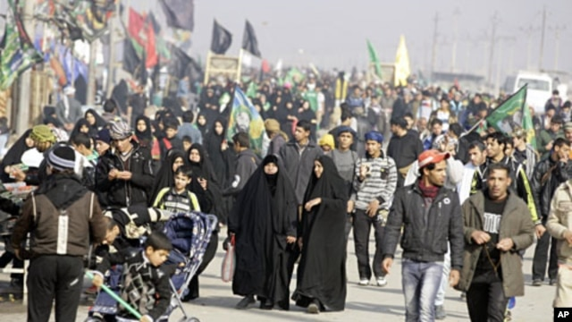 Shiite pilgrims march on their way to Karbala for Arbaeen in Baghdad, Iraq, January 9, 2012