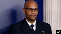 FILE - In this March 22, 2020, file photo U.S. Surgeon General Jerome Adams attends a coronavirus task force briefing at the White House, in Washington. Chicago is among several large American cities identified as hot spots for COVID-19 infections…