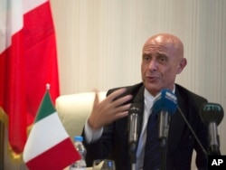 FILE - Italian Interior Minister Marco Minniti speaks during a meeting with Libyan Interior Minister Al-Arif Saleh Al-Khoja and the mayors of Libyan municipalities, to discuss the problem they face with migrants attempting to cross the Mediterranean Sea, July 13