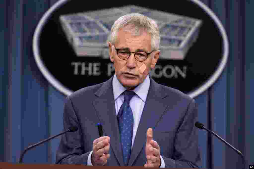 Defense Secretary Chuck Hagel speaks during a news conference at the Pentagon, Washington, Nov. 14, 2014.