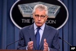 FILE - Then-Defense Secretary Chuck Hagel speaks during a news conference at the Pentagon, Nov. 14, 2014.