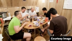 The Mars500 crew is shown having breakfast together inside one of the facility's modules. (European Space Agency/Institute for Biomedical Problems)