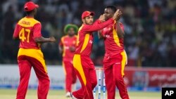 FILE: Zimbabwe players celebrate the dismissal of Pakistan's Ahmed Shahzad during a match at the Gaddafi Stadium in Lahore, Pakistan, Sunday, May 24, 2015. The Twenty20 matches Friday and Sunday mark a return of international cricket to Pakistan for the first time since gunmen attacked buses carrying the Sri Lankan cricket team and match officials in this eastern city six years ago. Security has been beefed up for the matches. (AP Photo/B.K. Bangash)