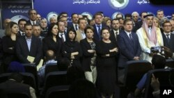 Iraqi lawmakers who attempted to oust the speaker of parliament gather during a news conference, in Baghdad, Iraq, April 14, 2016.