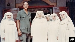 Dr. Augustus White, with a group of nuns at a Leper Colony in Vietnam in the late 1960s, as he was becoming increasingly aware of medical discrimination against minorities.