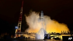 FILE - A Russian Soyuz-2 booster rocket takes off from the Plesetsk launch facility in northwestern Russia, Oct. 25, 2018. The rocket put a military satellite in orbit.