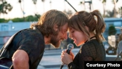 """Scene from 'A Star is Born"""" starring Bradley Cooper and Lady Gaga."""