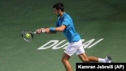 Novak Djokovic en actio, Dubai, Emirats Arabes Unis le 22 février 2016