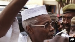 Former Chad dictator Hissène Habré, left, seen as he leaves the court in Dakar, Senegal, Nov. 25, 2005.
