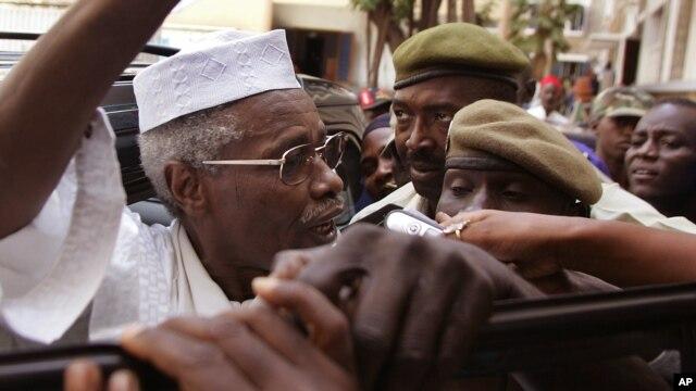 Former Chad dictator Hissène Habré, left,  seen as he leaves the court in Dakar, Senegal, Nov. 25, 2005.