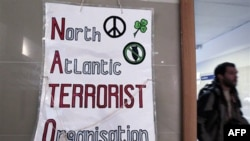 Плакат организаторов «контрсаммита НАТО»: Северо-атлантическая Террористическая Организация