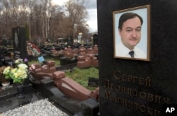 FILE - A tombstone on the grave of lawyer Sergei Magnitsky who died in jail, at a cemetery in Moscow, Nov. 16, 2012.