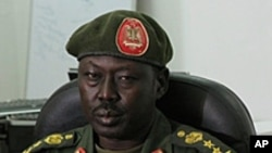 "FILE - SPLA spokesman Philip Aguer, shown here at a briefing in March 2012, says that ""if there are spoilers for the peace agreement, those spoilers at least are not on our side."""