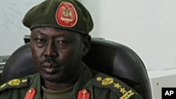 SPLA spokesman Philip Aguer, shown here at a briefing in March 2012, confirmed on Wednesday, May 8, 2013, that rebels led by David Yau Yau seized the town of Boma, in Jonglei state. (AP)