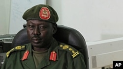 South Sudan army spokesman Philip Aguer, shown at a press conference in 2013, says government forces recaptured Bentiu on Friday, Jan. 10, 2014.