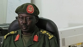 SPLA spokesman Philip Aguer, shown here at a briefing in March 2012, says five soldiers who were found guilty of murdering civilians in Jonglei state could be put to death.