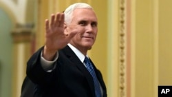 Vice President Mike Pence waves as he walks on Capitol Hill in Washington, Jan. 3, 2018.