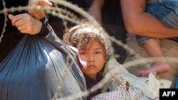 Migranti na granici Makedonije i Grčke