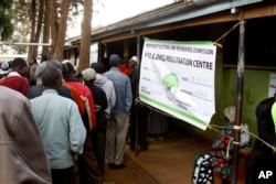 FILE - Kenyan voters line up to cast their votes in the Kibera slum, Nairobi, Kenya.