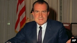 Richard Nixon at his desk at the White House