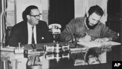Cuban dictator Fidel Castro signs an order to take over all American-owned banks in Cuba, Sept. 17, 1960.