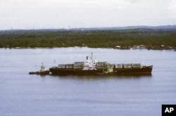 The arrival of the container ship SS Mayaguez after leaving Cambodia for Singapore, May 1975. (AP Photo)
