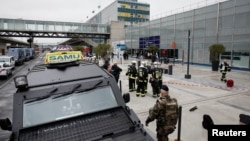 Military and emergency services outside Orly airport southern terminal after a shooting incident near Paris, France, March 18, 2017.
