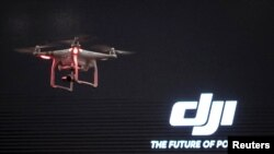 FILE - The DJI Phantom 3, a consumer drone, takes flight after it was unveiled at a launch event in Manhattan, New York, April 8, 2015.