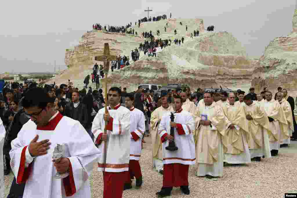 Pilgrims make their way to attend mass at the baptism site in Bethany, Jordan. Thousands of Catholics flocked to the site on the banks of the Jordan River to kick start the pilgrimage.