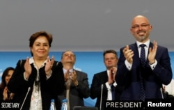 COP 24 President Michal Kurtyka and Executive Secretary of the UN Framework Convention on Climate Change Patricia Espinosa react after adopting the final agreement during a closing session of the COP24 U.N. Climate Change Conference 2018 in Katowice, Poland.