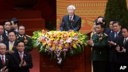 Newly re-elected Vietnam Communist Party General Secretary Nguyen Phu Trong, center, speaks at the closing ceremony of its five-yearly congress in Hanoi, Vietnam, Jan. 28, 2016.