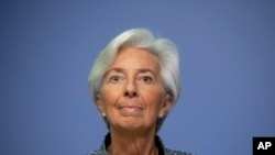 FILE -- In this Thursday, March 12, 2020 file photo the President of European Central Bank Christine Lagarde looks up prior to a press conference following a meeting of the ECB governing council in Frankfurt, Germany. The European Central Bank has…