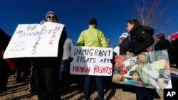 Supporters hold up a placard during a rally in for Jeanette Vizguerra, a Mexican woman seeking to avoid deportation from the United States, outside the Immigration and Customs Enforcement office in Centennial, Colorado.