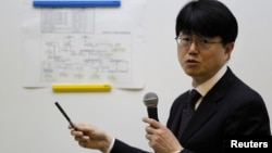 FILE - TEPCO General Manager Masayuki Ono speaks during a news conference at the company's head office in Tokyo, March 19, 2013.
