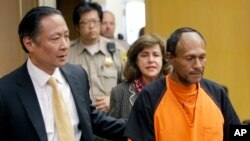 FILE - Jose Ines Garcia Zarate, right, is led into the courtroom by San Francisco Public Defender Jeff Adachi, left, and Assistant District Attorney Diana Garciaor, center, for his arraignment at the Hall of Justice in San Francisco, July 5, 2015.