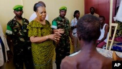 FILE - Central African Republic interim President Catherine Samba Panza visits battle victims at the general hospital in Bangui, June 1, 2014.