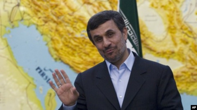 Iranian President Mahmoud Ahmadinejad jokes with journalists in Tehran, March 4, 2012.