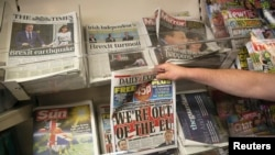 Headlines blare news of Britain's vote Thursday to leave the European Union, at a news kiosk in central London, June 25, 2016.