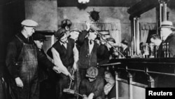 U.S. rrohibition agents destroy a bar in an undated photo held by the National Archives and Records Administration.