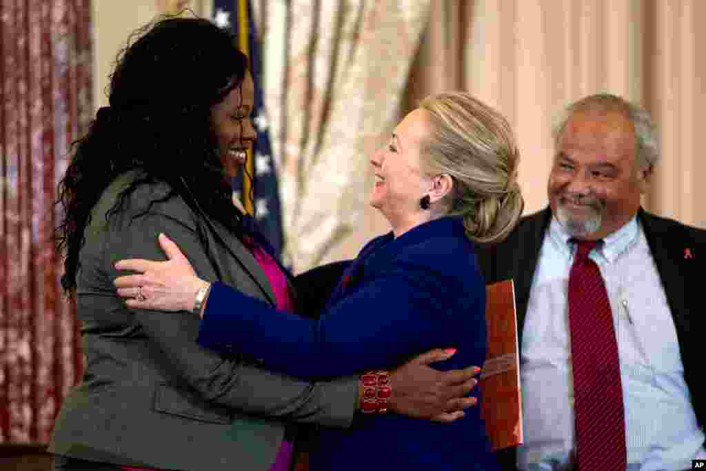 Secretary of State Hillary Clinton greets Florence Ngobeni-Allen, ambassador for the Elizabeth Glaser Pediatric AIDS Foundation, November 29, 2012, during a ceremony in recognition of World AIDS Day.