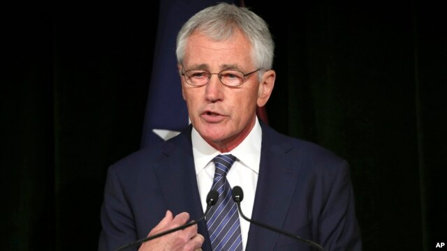 U.S. Secretary of Defense Chuck Hagel speaks during a press conference with Australia's Defense Minister David Johnston in Sydney, Australia, Aug. 11, 2014.