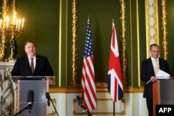 Mike Pompeo (L) speaks during a meeting with Britain's Foreign Secretary Dominic Raab