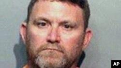 Skot Majkl Grin, 46-godišnji stanovnika Urbandejla optužen za ubistva policajaca