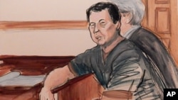 In this courtroom sketch, defendant Ng Lap Seng is seated at the defense table with his attorney during his arraignment on bribery charges in New York, Oct. 6, 2015.